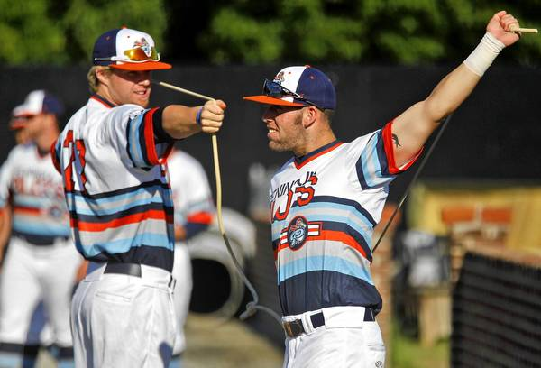 Peninsula Pilots Taylor Ostrich, left, and Tyler Urps talk while stretching before the start of a recent game against the Edenton Steamers at War Memorial Stadium.