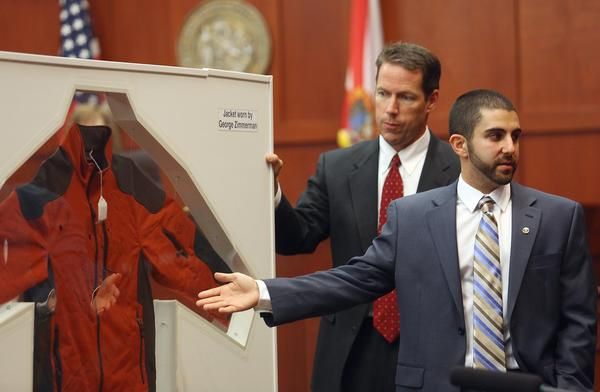 Crime Lab Analyst Anthony Gorgone points to a jacket worn by George Zimmerman on the night Zimmerman shot Trayvon Martin during the George Zimmerman trial in Sanford, Fla., on Wednesday.