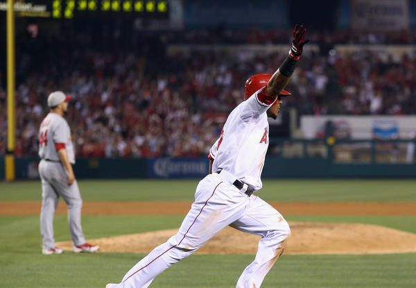 Angels shortstop Erick Aybar reacts after watching his line drive to left field land for the game-winning hit against the Cardinals in the ninth inning Thursday night in Anaheim.