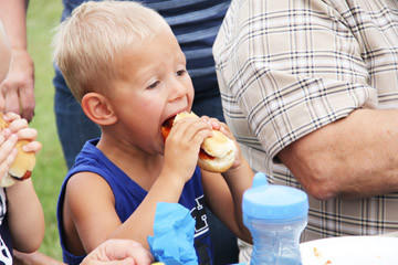 Sean Deckert of Parkston, 3, came to the community potluck in Doland with his grandparents and younger brother, Luke.