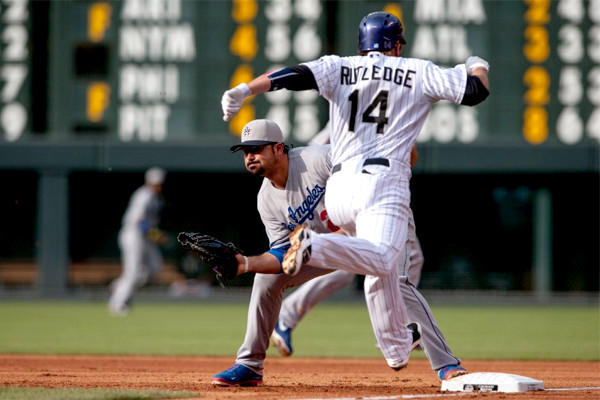 Josh Rutledge is out by a half step as Adrian Gonzalez catches the throw to first base in the first inning of the Dodgers' 9-5 loss to the Colorado Rockies.