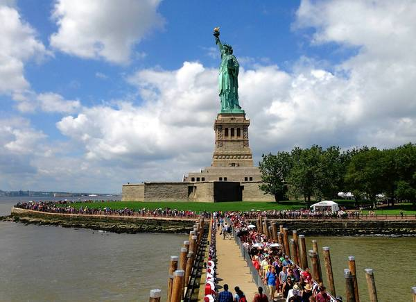Crowds visit the Statue of Liberty for the first time since it was closed in October because of damage from Susperstorm Sandy.