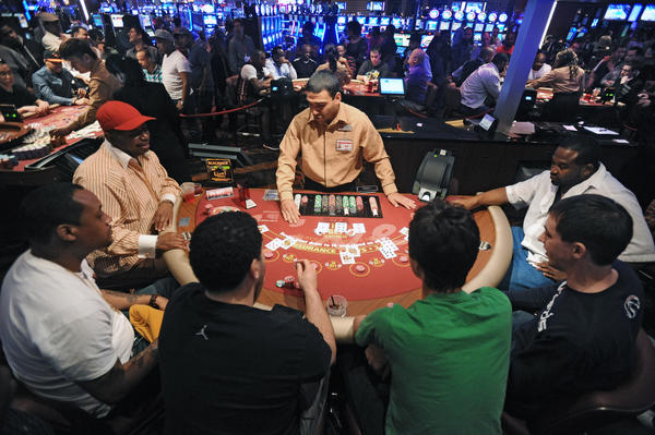 Game tables are crowded as live action table games at Maryland Live Casino opened to the public.