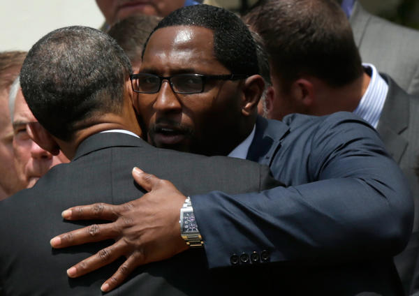Baltimore Ravens linebacker Ray Lewis (right) hugs U.S. President Barack Obama after Obama welcomed members of the Super Bowl champion Ravens to the White House in June.