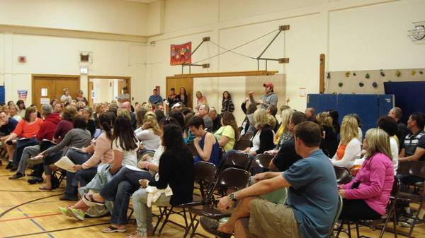 Parents attend a meeting at Jefferson Elementary School to learn about how their school may be impacted if students transfer from Conrad Fischer school.