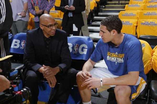 Golden State Warriors Klay Thompson talks with his father Mychal on May 10.