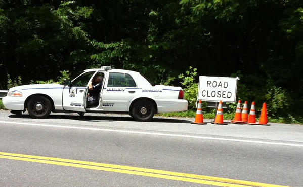 Shannondale Springs Road in Jefferson County, W.Va., was closed Friday as authorities continued the search for a Winchester, Va., man who was missing in the Shenandoah River.