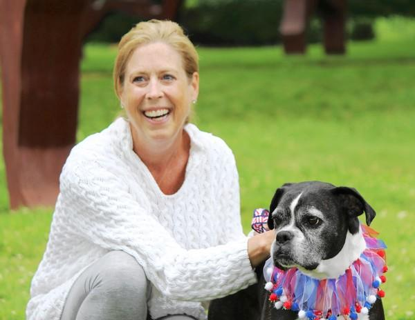 "Highland Park resident Dawn LoCascio, pictured with her pet Macie Beans, has petitioned the City Council to outlaw the sale of animals bred in ""puppy mills"" and other breed-for-profit businesses."