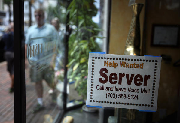 A hiring sign at a restaurant Friday in Alexandria, Va. The Labor Department reported that the U.S. economy added 195,000 jobs in June, with the unemployment rate remained unchanged at 7.6%.