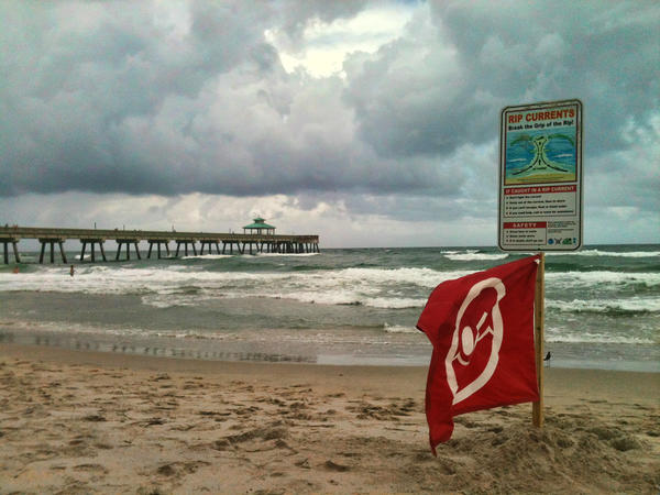 Rip current warnings at Deerfield Beach where the water was choppy and the weather ominous Friday afternoon