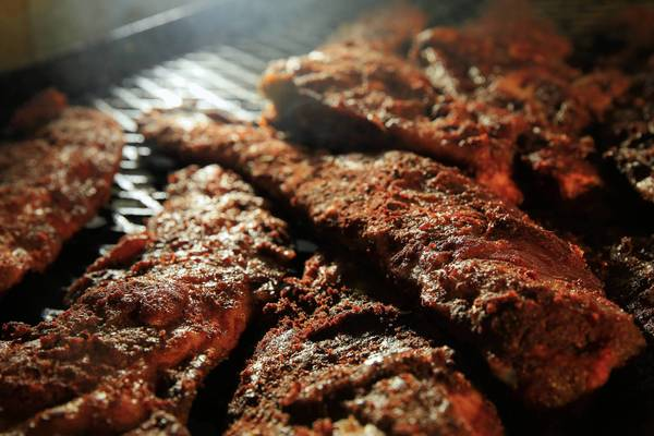 "Ribs and briskets cook in the large ""aquarium"" style smoker at Elgin BBQ Pit in Elgin."