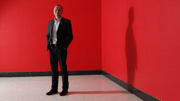Morningstar CEO Joe Mansueto is photographed in the company's lobby in 2012.
