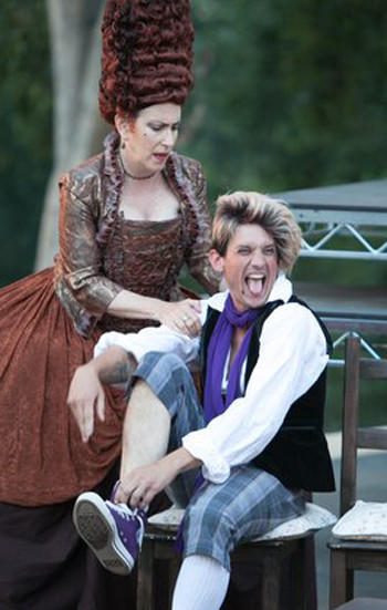 "Mrs. Hardcastle (Bernadette Sullivan) spoils her impish grown son, Tony Lumpkin (Andr Martin), in ""She Stoops to Conquer"" in Griffith Park."