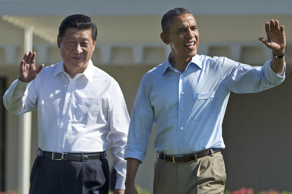 President Barack Obama and Chinese President Xi Jinping walk at the Annenberg Retreat of the Sunnylands estate in Rancho Mirage, Calif., where they met to discuss future relations.