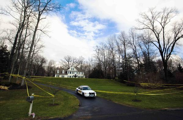 A police cruiser sits parked in the driveway outside Nancy Lanza's Sandy Hook home in Newtown on Dec. 18, just days after the massacre.