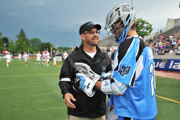 Bear Davis of the Ohio Machine talks with Logan Schuss #20 of the Ohio Machine before the start of the game against the Boston Cannons on June 29.