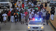 Baltimore men march to stem violence