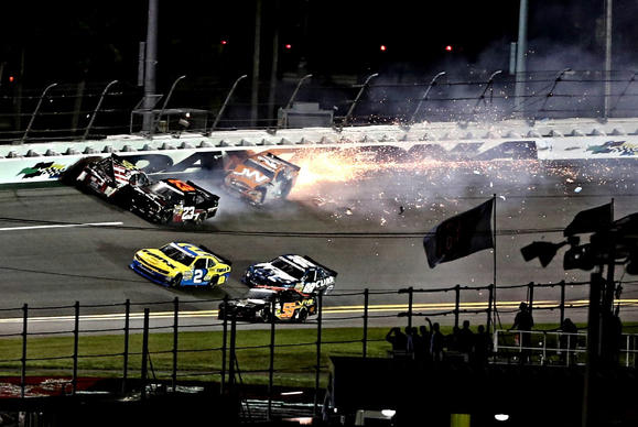 DAYTONA BEACH, Fla. -- jason white #24 catches fire in a crash at Daytona International Speedway, five laps from the end of the NASCAR Nationwide series 250 race, July 5, 2013. (Joe Burbank/Orlando Sentinel) Newsgate CCI ID:  B583037855Z.1