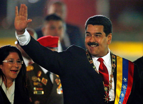 Venezuelan President Nicolas Maduro, with his wife, waves upon arrival for an independence day parade in Caracas on Friday.