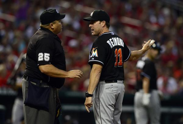 Jul 5, 2013; St. Louis, MO, USA; Miami Marlins manager Mike Redmond (11) argues a call with umpire Fieldin Culbreth (25) during the fourth inning at Busch Stadium. St. Louis defeated Miami 4-1. Mandatory Credit: Jeff Curry-USA TODAY Sports ORG XMIT: USATSI-122902