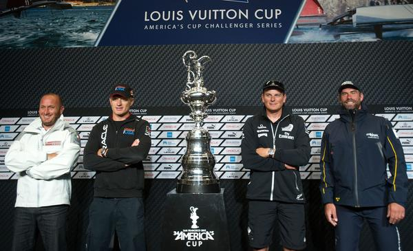Skippers pose with the America's Cup trophy following a news conference Friday in San Francisco. From left are Luna Rossa Challenge's Max Sirena, Team Oracle USA's Jimmy Spithill, Emirates Team New Zealand's Dean Barker and Artemis Racing's Iain Percy.