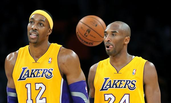 Dwight Howard, left, and Kobe Bryant walk off the court following a game against the Milwaukee Bucks in January. Howard didn't accomplish much in his one season with the Lakers.