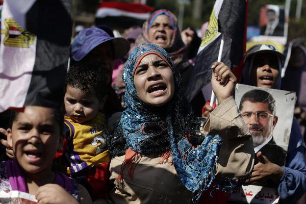Supporters of Egypt's ousted President Mohammed Morsi chant slogans Saturday near the University of Cairo in Giza, Egypt.