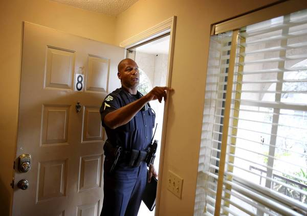 Orlando Police Department Crime Prevention and Community Liaison Officer Cpl Kevlon Kirkpatrick inspects a downtown Orlando apartment for on April 4, 2013. Kirkpatrick gave tips on how to keep the apartment safe from burglars.