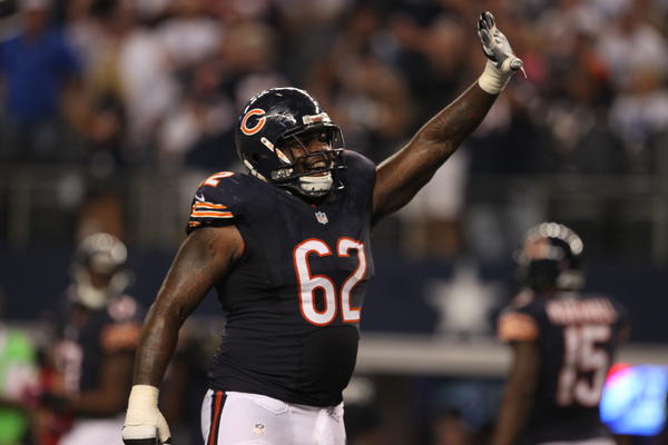 Bears guard Chilo Rachal waves to the fans after a Devin Hester touchdown during a game against the Cowboys.