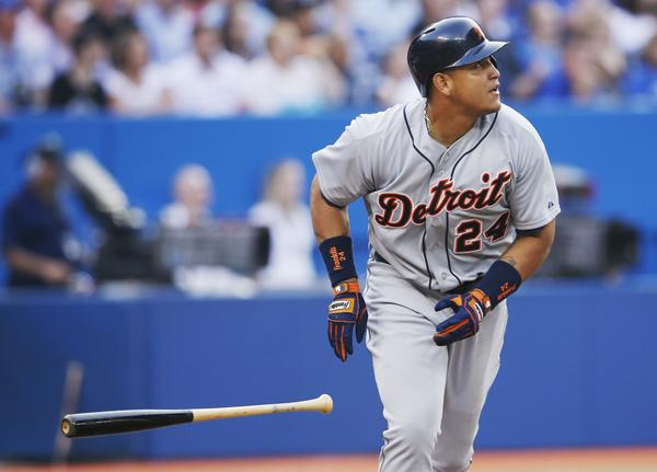 The Tigers' Miguel Cabrera hits a three-run home run against the Blue Jays.