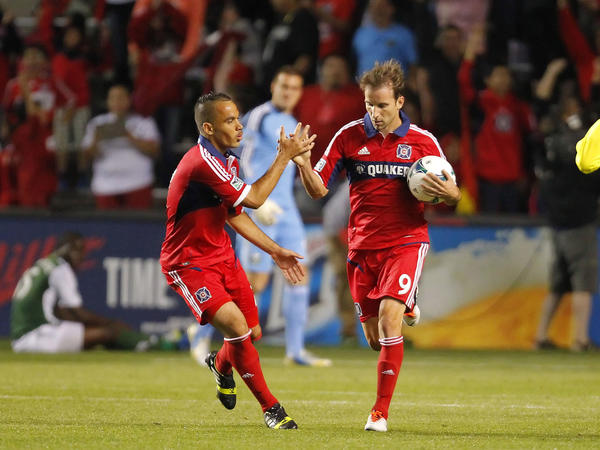 Mike Magee (right) is congratulated by Alex after scoring a goal during the second half against the Timbers at Toyota Park.