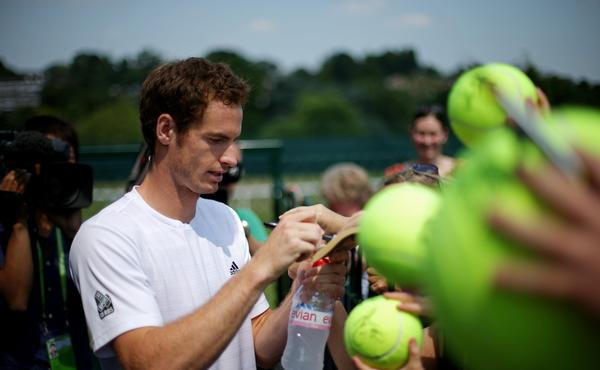 Andy Murray signs autographs for fans after a practice session at Wimbledon on Saturday.