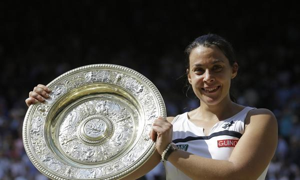 Marion Bartoli smiles with the Venus Rosewater Dish after winning the women's singles championship at Wimbledon on Saturday.