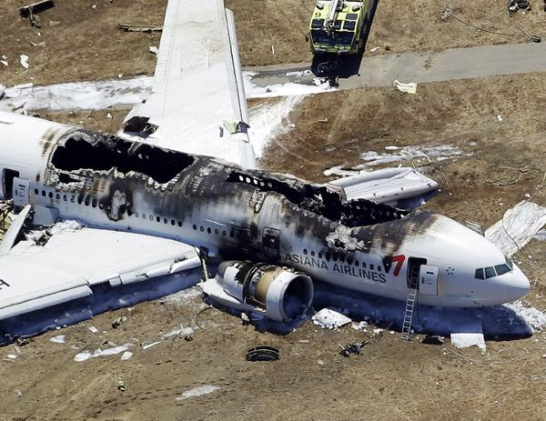 The charred wreckage of the Asiana Airlines flight from South Korea lies at the San Francisco International Airport after it crashed during landing.