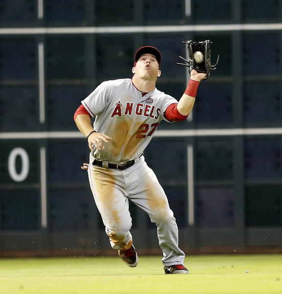The Angels' Mike Trout makes a catch on a fly ball.