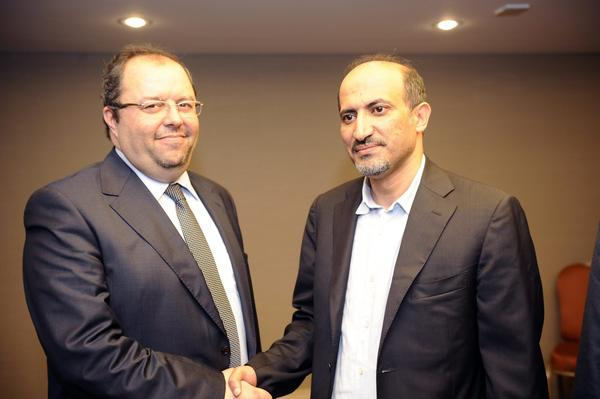 In Istanbul, Turkey, newly elected Syrian opposition leader Ahmad Assi Jarba, right, shakes hands with Mustafa Sabbagh, who was runner-up for the presidency of the Syrian National Coalition.