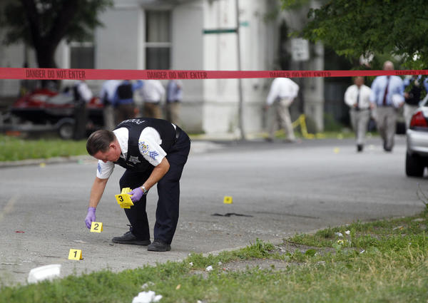Chicago police investigate the scene at Flournoy Street and Francisco Avenue where at least seven people were shot in the Lawndale neighborhood.