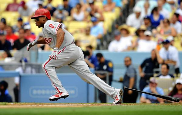 June 30, 2013; Los Angeles, CA, USA; Philadelphia Phillies center fielder Ben Revere (2) hits a single during the fifth inning against the Los Angeles Dodgers at Dodger Stadium.