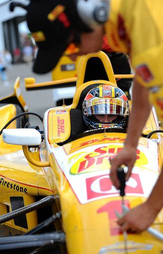 Ryan Hunter-Reay driver of the #1 DHL Chevroletwaits for his crew members to work on adjustments during morning practice for the Pocono INDYCAR 400 Fueled by Sunoco Saturday.