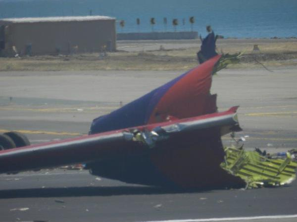 A piece of an Asiana Airlines Boeing 777 that broke off after the jetliner crashed at San Francisco International Airport, as seen from a neighboring plane.