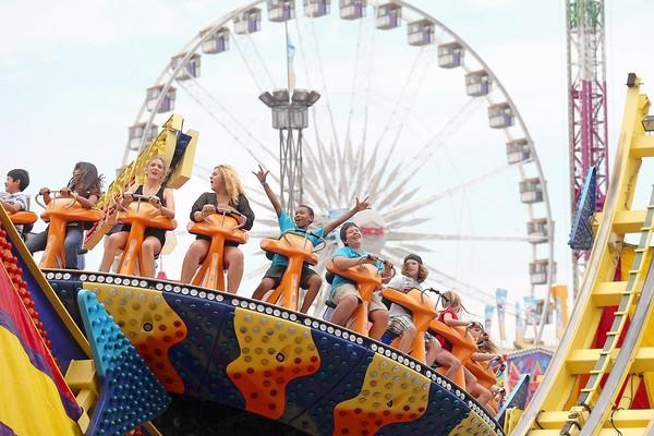 Riders cheer as they take a spin aboard the Disk 'O during last year's opening day of the OC Fair. This year's festivities get under way July 12.