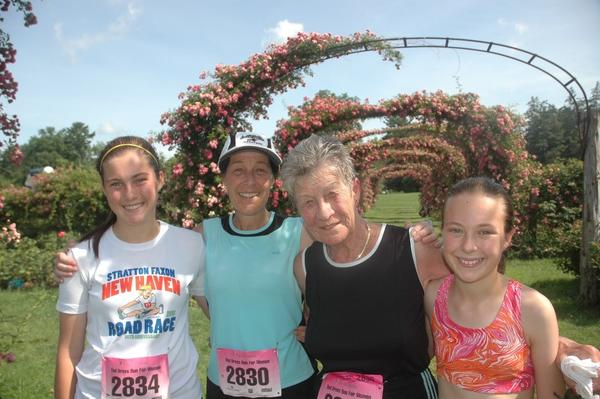 From left, Katie Overstrum, her mother Kris, her grandmother Betty Holroyd and Katie's younger sister Betsy, all of Wallingford, pose in the rose garden at Elizabeth Park after the Red Dress Run 5K Saturday morning.
