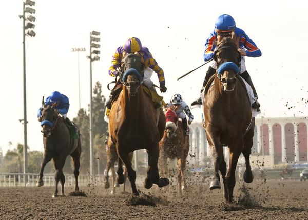 Game On Dude and jockey Mike Smith, right, overpower Kettle Corn and jockey Rafael Bejarano to win the $500,000 Grade I Hollywood Gold Cup on Saturday for the second straight year.