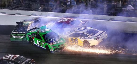 Danica Patrick and others tangle at the finish line at the  Coke Zero 400 at Daytona International Speedway, in Daytona Beach, Fla., Saturday, July  6, 2013. Joe Burbank/Orlando Sentinel) newsgate CCI  B583037860Z.1