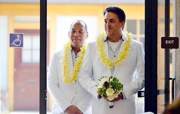 Jose A. Lopez-Mercedes, left, and Steven Fenn Jr., both of Anaheim, prepare to enter the doors to their wedding ceremony at Orange Coast Universalist Church in Costa Mesa on Saturday.
