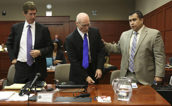 George Zimmerman, right, greets his attorneys Mark O'Mara, left, and Don West at his second-degree murder trial in Sanford, Fla.
