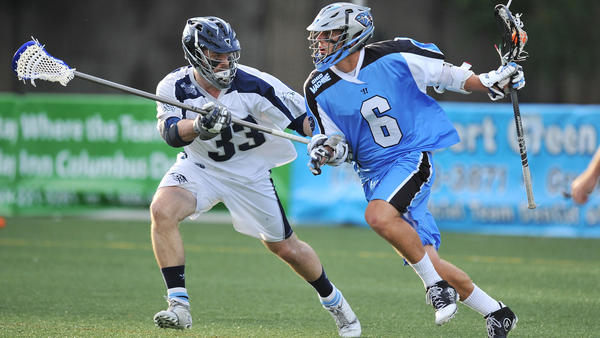 Michael Evans (33) of the Chesapeake Bayhawks defends against Steele Stanwick of the Ohio Machine in the first quarter at Selby Stadium in Delaware, Ohio.