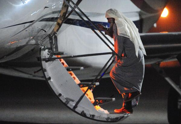Radical cleric Abu Qatada boards a private flight at a Royal Air Force base near London.