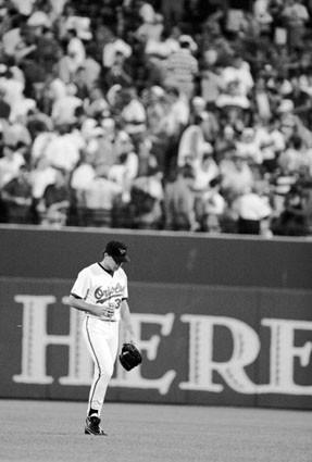 Mike Mussina walks off the field at Camden Yards after not getting a chance to pitch in the All-Star game.