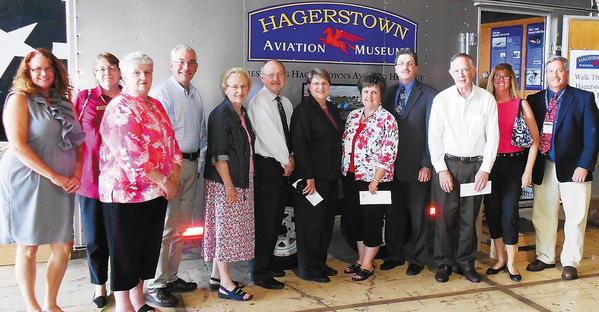 Several members of Washington County nonprofits received funds June 4 from the Mary K. Bowman Historical and Fine Arts Fund at the Hagerstown Aviation Museum. They are, from left, Kirsten Hubbard, Fort Ritchie Community Center; Carol Appenzellar, Washington County Free Library; Betty Moore, Hagerstown Day Nursery; Jim Pierne, Washington County Arts Council; Leslie Hobbs, Discovery Station; Michael Jones, Maryland Symphony Orchestra; Vicki Willman, MSO; Trina Johnson, Hagerstown Day Nursery; Wallace Lee, Washington County Museum of Fine Arts; Gary Graves, Robert W. Johnson Community Center (formerly Memorial Recreation Center); Terri Siefert, San Mar Childrens Home; and John Seburn, Hagerstown Aviation Museum.